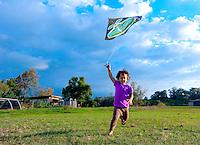 Young Hawaiian girl flying a kite