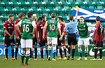Hibs v St Johnstone....21.12.13    SPFL<br /> Scott Robertson is booked by ref Alan Muir for complaining that the wall wasn't back 10 yards<br /> Picture by Graeme Hart.<br /> Copyright Perthshire Picture Agency<br /> Tel: 01738 623350  Mobile: 07990 594431