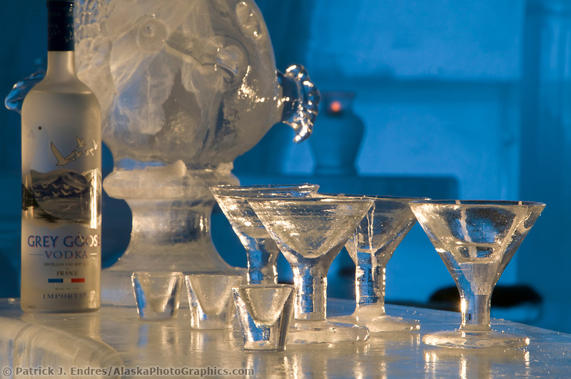 Glasses made out of ice. Aurora Ice Hotel, Chena Hot Springs, Alaska. A 30 ft. high gothic style ice structure built from ice and snow by World Ice Sculpting champion Steve Brice. The hotel includes an ice bar, lobby, stage, ice chandeliers, and six hotel rooms kept at 28 degrees Fahrenheit that can be rented for a unique overnight stay under the northern lights.