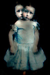 Conceptual image of female child with two heads blurred