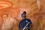 One of the traditional owners explaining the rock art at Raft Point, Kimberley Coast, Australia