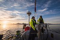 Navigating through ice flows at sunset towards harbor at Tasiilaq, east Greenland