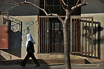 A Druze Sheikh walks by in Majdal Shams, Golan Heights.<br />
