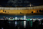 The man-made island of Odaiba, looking toward Rainbow Bridge and the business district across the water in Tokyo, Japan.