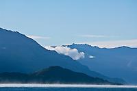 Morning mist rising off lake Wakatipu, Queenstown, New Zealand
