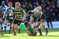 Harry Thacker of Leicester Tigers looks to fend Courtney Lawes of Northampton Saints. Aviva Premiership match, between Northampton Saints and Leicester Tigers on April 16, 2016 at Franklin's Gardens in Northampton, England. Photo by: Patrick Khachfe / JMP