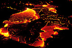 Surface lava flowing at night, Hawaii Volcanoes National Park, The Big Island, Hawaii USA