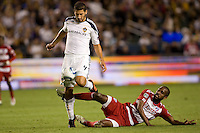 Omar Gonzalez (wht) LA Galaxy defender steals the ball away from advancing FC Dallas forward Atiba Harris (red). FC Dallas defeated the LA Galaxy 3-0 to win the Western Division 2010 MLS Championship at Home Depot Center stadium in Carson, California on Sunday November 14, 2010.