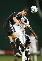Branko Boskovic #27 of D.C. United wins a header against Edson Buddle #14 of the Los Angeles Galaxy during an MLS match at RFK Stadium on July 18 2010, in Washington D.C. Galaxy won 2-1.