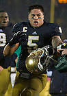 Oct. 13, 2012; Linebacker Manti Te'o celebrates after Notre Dame defeated Stanford 20 to 13 in overtime . Photo by Barbara Johnston/University of Notre Dame