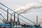 Smoke rises from stacks at the Port of Rotterdam, on Tuesday Oct. 27, 2009, in Rotterdam, the Netherlands. (Photo © Jock Fistick)
