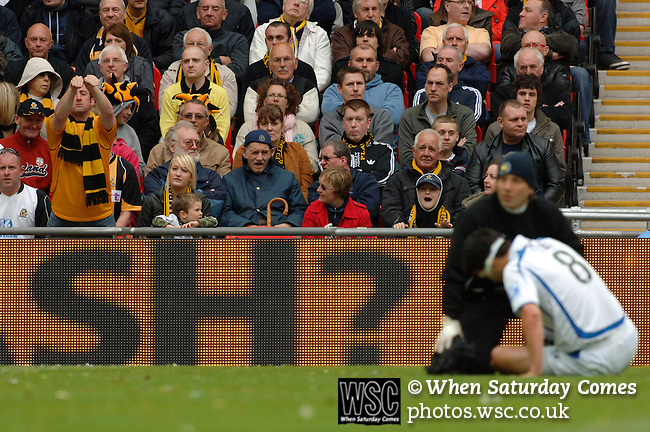 Torquay United 2 Cambridge United 0, 17/05/2009. Wembley Stadium, Conference Play Off Final. A Cambridge supporter seems to think Tim Sills of Torquay took a dive to win a free kick and waste precious seconds for his team. Torquay United returned to the Football League after two years away following victory at Wembley. Photo by Simon Gill.