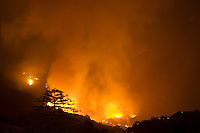 Santa Barbara, California - Large flames and smoke as Jesusita fire burns out of control on Wednesday night, May 6, 2009