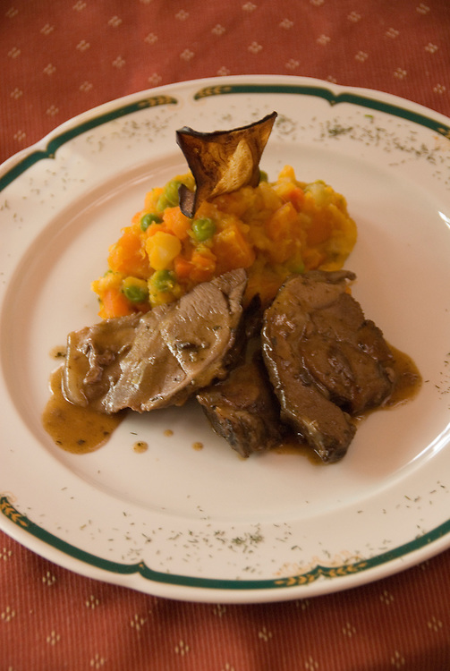Chile, Lake Country: Hotel Natura in Peulla, scene of fine dining and luxury lodging. Roasted lamb dish..Photo #: ch666-33231..Photo copyright Lee Foster www.fostertravel.com, lee@fostertravel.com, 510-549-2202.