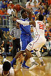 UK freshman forward Alex Poythress is guarded by UF freshman guard Michael Frazier II during the first half of the University of Kentucky vs. University of Florida men's basketball game at the O'Connell Center in Gainesville, Fl., on Tuesday, February 12, 2013. UK lost 69-52. Photo by Tessa Lighty | Staff