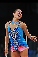 Aliya Garaeva of Azerbaijan expresses with hoop during Event Finals at 2010 World Cup at Portimao, Portugal on March 14, 2010.  (Photo by Tom Theobald).