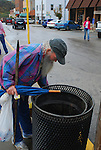 B.J. 'Tin Can Man' Miller searched through a trash bin on Oct. 14th for  empty tin cans. Miller roams the streets every day, scouring the trash for cans that he returns for their deposit.  .Photo by Sam Verbulecz
