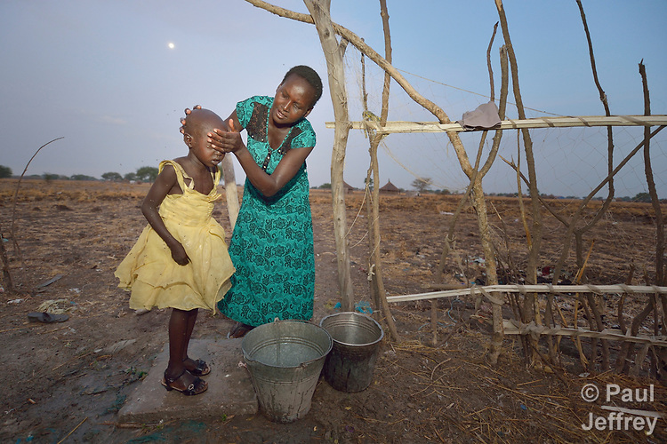 Rebecca Achol Atem washes her 5-year old daughter Saloma Nyandeng's face early in the morning on April 13, 2017, as she gets the girl ready to go to an early childhood development center in Panyagor, a town in South Sudan's Jonglei State. <br /> <br /> The Lutheran World Federation, a member of the ACT Alliance, is helping families in the region, which is torn by both war and drought, to educate their children, with a special focus on insuring that girls enter and remain in school.