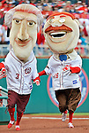 12 April 2012: The Racing Presidents, mascots for the Washington Nationals, entertain the fans at Opening Day against the Cincinnati Reds at Nationals Park in Washington, DC. The Nationals defeated the Reds 3-2 in 10 innings to take the first game of their 4-game series. Mandatory Credit: Ed Wolfstein Photo