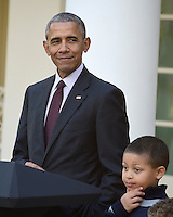 United States President Barack Obama, left, joined by nephew Austin Robinson, 6, makes remarks as he pardons the 2016 National Thanksgiving Turkey, Tater, and its alternate Tot, during a ceremony in the Rose Garden of the White House in Washington, DC on Wednesday, November 23, 2016.  This is the 69th anniversary of this honored tradition began in 1947 by President Harry S Truman.  Once pardoned the birds will be sent to their new home at Virginia Tech&rsquo;s Animal and Poultry Sciences Department at &ldquo;Gobbler's Rest&rdquo; in Blacksburg, Virginia where they will be cared for by students and veterinarians.<br /> Credit: Ron Sachs / CNP /MediaPunch