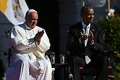 (L-R) Pope Francis and U.S. President Barack Obama applaud during the arrival ceremony at the White House on September 23, 2015 in Washington, DC. The Pope begins his first trip to the United States at the White House followed by a visit to St. Matthew's Cathedral, and will then hold a Mass on the grounds of the Basilica of the National Shrine of the Immaculate Conception.  <br /> Credit: Win McNamee / Pool via CNP
