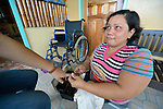 Novi Grace Beocadez, 38, lives with a disability and earns her living caring for nails in Concepcion, Philippines. The town bore the brunt of Typhoon Haiyan, known locally as Yolanda, in November 2013. Beocadez is a member of the local Persons with Disabilities (PWD) group.