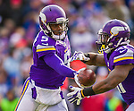 19 October 2014: Minnesota Vikings quarterback Teddy Bridgewater makes a hand-off to running back Jerick McKinnon in the fourth quarter at Ralph Wilson Stadium in Orchard Park, NY. The Bills defeated the Vikings 17-16 in a dramatic, last minute, comeback touchdown drive. Mandatory Credit: Ed Wolfstein Photo *** RAW (NEF) Image File Available ***
