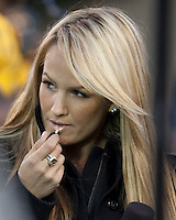 ESPN sideline reporter Jenn Brown puts on lipstick. The West Virginia Mountaineers defeated the South Florida Bulls 20-6 on October 14, 2010 at Mountaineer Field, Morgantown, West Virginia.