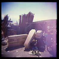 A woodworkers sells coffins by the side of the road on Thursday, November 25, 2010 in Titanyen, Haiti.
