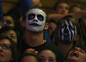"A Cameron Crazie watches the scoreboard. Duke men's basketball had an opening scrimmage game as a part of the ""Countdown to Craziness"" event at Cameron Indoor Stadium Friday Oct. 14, 2011.  Photo by Al Drago..."