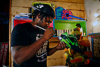 Baron Batch painting at Studio A.M. in Homestead, Pennsylvania. (Photo by Jared Wickerham/Wick Photography)
