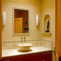 In the bathroom the walls are built from adobe with a traditional alcove containing a small antique figurine