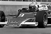 INDIANAPOLIS, IN: Mario Andretti drives out of the pit lane in his McLaren M24 3/Cosworth TC during practice for the Indianapolis 500 on May 29, 1977, at the Indianapolis Motor Speedway.