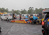 Aug 20, 2016; Brainerd, MN, USA; Crew members move the car of NHRA top fuel driver Luigi Novelli during a rain delay to qualifying for the Lucas Oil Nationals at Brainerd International Raceway. Mandatory Credit: Mark J. Rebilas-USA TODAY Sports