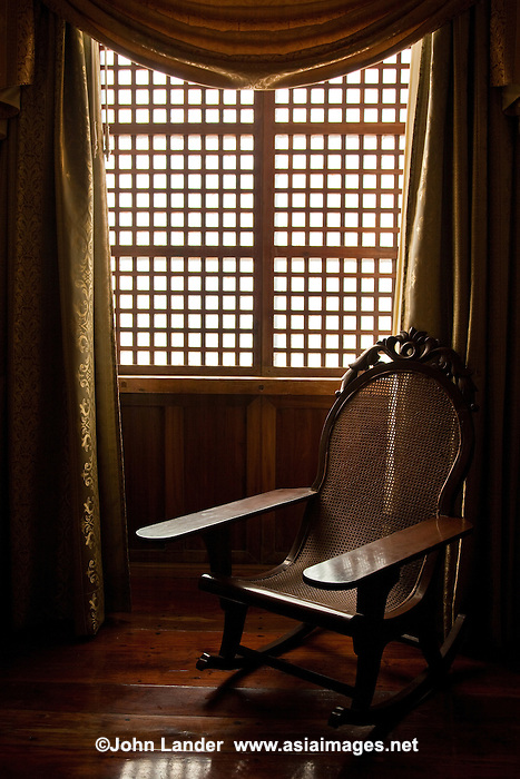 Windows made of capiz shells were originally chosen because it was cheaper to make windows of capiz than glass during the Spanish Colonial period of the Philippines.  They continued to be made, however, thanks to their ability to allow enough light through and their strength in holding up to typhoons.