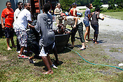 Beating the heat at the Rooted In Community Conference, Goldsboro, N.C., July 24, 2010