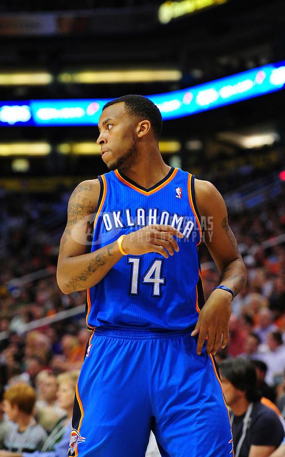Mar. 30, 2011; Phoenix, AZ, USA; Oklahoma City Thunder guard (14) Daequan Cook against the Phoenix Suns at the US Airways Center. Mandatory Credit: Mark J. Rebilas-