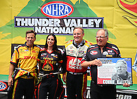 Jun 21, 2015; Bristol, TN, USA; NHRA Connie Kalitta (right) with team members (R-L) top fuel driver, Doug Kalitta, funny car drivers Alexis DeJoria and Del Worsham.  Connie Kalitta receives an award as he was inducted into the Legends of Thunder Valley during the Thunder Valley Nationals at Bristol Dragway. Mandatory Credit: Mark J. Rebilas-