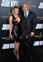 Tito Ortiz &amp; Amber Miller at the premiere of &quot;John Wick Chapter Two&quot; at the Arclight Theatre, Hollywood. <br /> Los Angeles, USA 30th January  2017<br /> Picture: Paul Smith/Featureflash/SilverHub 0208 004 5359 sales@silverhubmedia.com