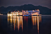 Lovely reflection of the Taj Lake Palace lights in the waters of Lake Pichola at twilight. (Photo by Matt Considine - Images of Asia Collection)