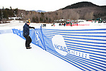 FRANCONIA, NH - MARCH 10:   A volunteer erects finish area fencing prior to the Slalom event at the Division I Men's and Women's Skiing Championships held at Cannon Mountain on March 10, 2017 in Franconia, New Hampshire. (Photo by Gil Talbot/NCAA Photos via Getty Images)