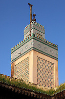 Low angle view of Minaret, Bou Inania Madrasa, Fez, Morocco, pictured on February 25, 2009 in the morning. The Bou Inania Madrasa was founded as a boarding school and mosque in AD 1351-56 by Abu Inan Faris, also the founder of the Bou Inania Madrasa in Meknes, and holds the status of Grand Mosque. A fine example of Marenid architecture with its intricate plasterwork, carved cedar and decorated tiles or zellij it is the only mosque in Fez open to non-Muslim visitors. It was renovated in the 18th and 20th centuries. Fez, Morocco's second largest city, and one of the four imperial cities, was founded in 789 by Idris I on the banks of the River Fez. The oldest university in the world is here and the city is still the Moroccan cultural and spiritual centre. Fez has three sectors: the oldest part, the walled city of Fes-el-Bali, houses Morocco's largest medina and is a UNESCO World Heritage Site;  Fes-el-Jedid was founded in 1244 as a new capital by the Merenid dynasty, and contains the Mellah, or Jewish quarter; Ville Nouvelle was built by the French who took over most of Morocco in 1912 and transferred the capital to Rabat. Picture by Manuel Cohen.