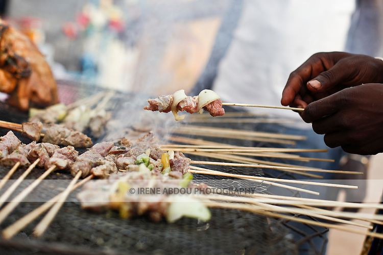 Vendors sell brochettes, chicken, and other food at the Salon International de l'Artisanat de Ouagadougou (Ouagadougou International Arts & Crafts Fair) in Burkina Faso.