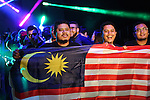 Malaysian fans with a Malaysian flag flank the walkway down to the ring, all eager to shake hands with the stars.<br />