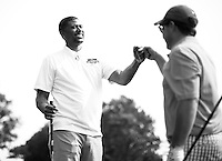 Jalen Rose celebrates with Bill Pulte during the 5th annual Jalen Rose Leadership Academy golf tournament at the Detroit Golf Club in Detroit, Michigan on Monday August 31, 2015. (Photo by Jared Wickerham/The Players Tribune)