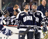 Jay Camper (UNH - 17), Austin Block (UNH - 3) - The University of Maine Black Bears defeated the University of New Hampshire Wildcats 5-4 in overtime on Saturday, January 7, 2012, at Fenway Park in Boston, Massachusetts.