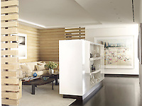 An intimate seating area is tucked away in a wood panelled niche in the hallway and furnished with wall to wall seating