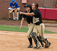 NWA Democrat-Gazette/ANTHONY REYES @NWATONYR<br /> Josie Vaught (left) and Jessicca Williams, both of De Queen, look to the rest of the team after the final out against Valley View Friday, May 19, 2017 in the 5A State Softball Championship at Bogle Park in Fayetteville. De Queen won 4-1.