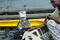 New York, USA. 22nd May, 2014. A girl checks a simulate riffle during the Fleet Week at pier 92 in Manhattan, New York.  Kena Betancur/VIEWpress