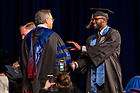 May 21, 2017; Former baseball and football player Torii Hunter, Jr. receives his diploma from Dean Roger Huang during the Mendoza College of Business undergraduate Commencement ceremony, 2017. (Photo by Matt Cashore/University of Notre Dame)